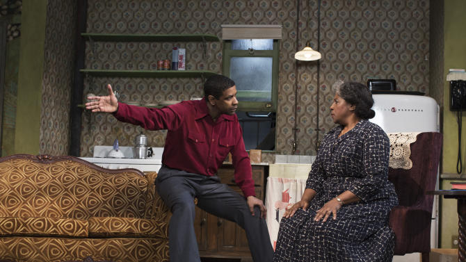 """This image released by Philip Rinaldi Publicity shows Denzel Washington, left, and LaTanya Richardson Jackson during a performance of """"A Raisin in the Sun,"""" at the Ethel Barrymore Theatre in New York. (AP Photo/Philip Rinaldi Publicity, Brigitte Lacombe)"""