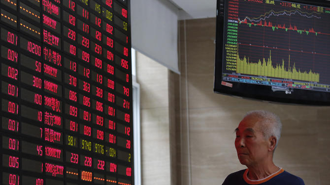 An investor looks at a stock prices monitor at a private securities company Monday, Aug. 26, 2013 in Shanghai, China. Asian stock markets mostly rose Monday after expectations for an imminent phasing out of the Federal Reserve's monetary stimulus program began to fade. (AP Photo)