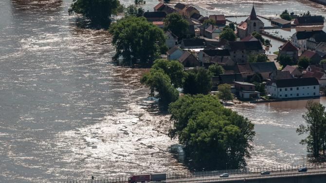 A view from  Radobyl  hill at a highway and the village Mlekojedy flooded by the swollen river Elbe near Litomerice, 70 kilometres (43 miles) northwest of Prague,  taken on Wednesday, June 5, 2013. Heavy rainfalls caused flooding in Germany, Austria, Switzerland and the Czech Republic. (AP Photo/CTK, Radek Petrasek) SLOVAKIA OUT