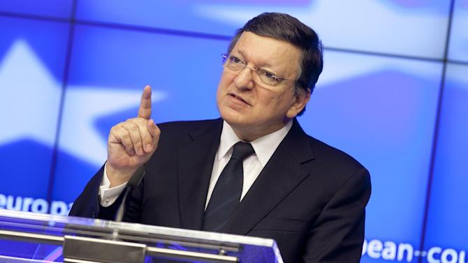 European Commission President Jose Manuel Barroso gestures while speaking during a media conference at an EU summit in Brussels on Friday, June 28, 2013. After late night budget talks, European Union leaders are turning their attention away from their financial troubles Friday and toward embracing once-troubled Balkan countries. (AP Photo/Virginia Mayo)