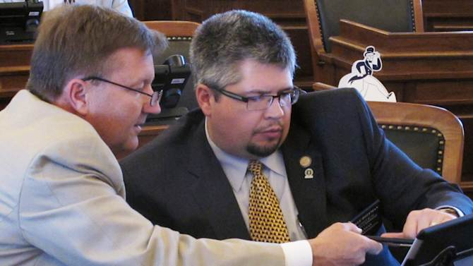 Kan. governor: Private GOP tax talks 'going well'