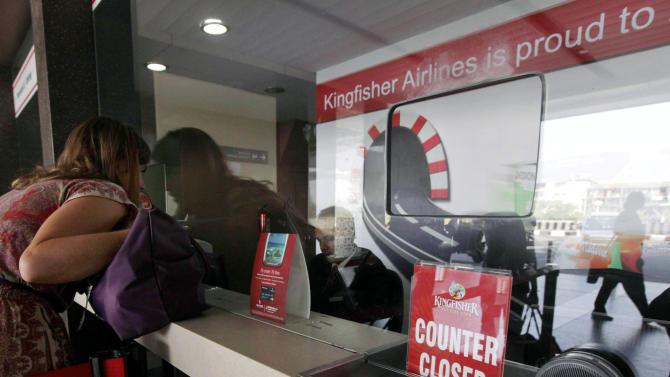A closed sign is displayed at a Kingfisher Airlines booking counter in Mumbai, India, Friday, Nov. 11, 2011. Kingfisher, which is partly owned by brewery tycoon Vijay Mallya, has canceled more than 120 flights this week as pilots and crew called in sick after their October salaries were delayed. (AP Photo/ Rajanish Kakade)