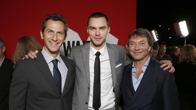 "Lionsgate Motion Picture Group President of Production Erik Feig, Actor Nicholas Hoult and Lionsgate Motion Picture Group Co-Chairman Patrick Wachsberger attend the LA Premiere of ""Warm Bodies"" at the ArcLight Cinerama Dome on Tuesday, Jan. 29, 2013 in Los Angeles, California. (Photo by Todd Williamson/Invision for The Hollywood Reporter/AP Images)"