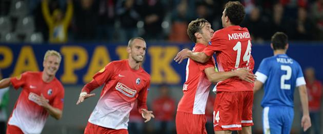 Freiburg's Julian Schuster  third from right,  celebrates with teammates  from left,  Mike Hanke  PavelKrmas and Admir Mehmedi after scoring the opening goal   during the UEFA Europa League Group H so