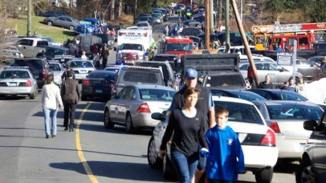 Parents pick up their children near Sandy Hook Elementary School in Newtown, Conn., after Friday's deadly shooting.