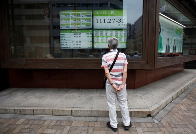 Asia stocks slide after Wall Street losses, oil drops on glut concerns