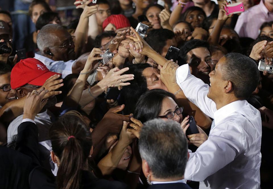 President Barack Obama greets supporters during a campaign event at Desert Pines High School, Sunday, Sept. 30, 2012 in Las Vegas. (AP Photo/Pablo Martinez Monsivais)