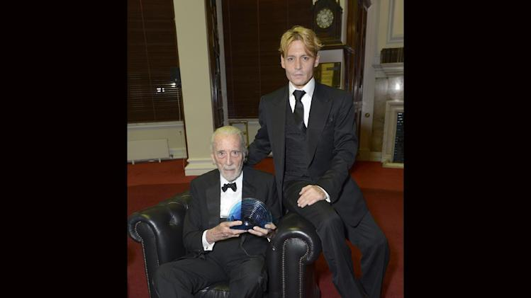 British actor Sir Christopher Lee receives the BFI Fellowship award from American actor Johnny Depp at he 57th BFI London Film Festival Awards Night at Banqueting House Whitehall, on Saturday Oct. 19, 2013, in London. (Photo by Jon Furniss/Invision for BFI/AP Images)