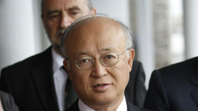 "Director General of the International Atomic Energy Agency, IAEA, Yukiya Amano, right, from Japan speaks to the media after returning from Iran at the Vienna International Airport near Schwechat, Austria, on Tuesday, May 22, 2012. Amano says he has reached a deal with Iran on probing suspected work on nuclear weapons and adds that the agreement will ""be signed quite soon."" (AP Photo/Ronald Zak)"
