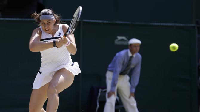 Marion Bartoli of France plays a return to Sabine Lisicki of Germany during their Women's singles final match at the All England Lawn Tennis Championships in Wimbledon, London, Saturday, July 6, 2013. (AP Photo/Anja Niedringhaus)