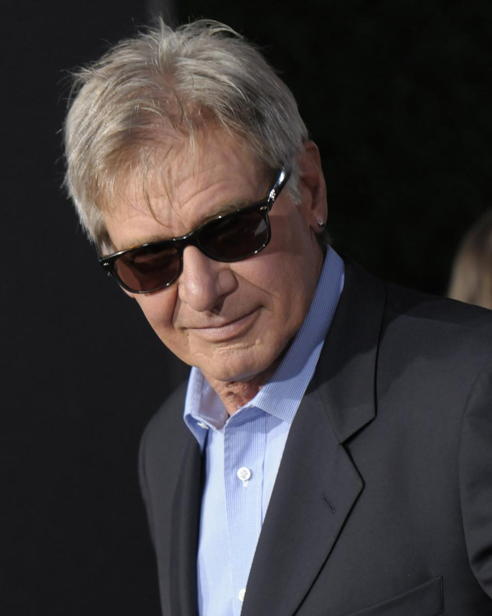 "Actor Harrison Ford arrives at the premiere of the feature film ""Cowboys and Aliens"" at Comic Con in San Diego, Calif. on Saturday, July 23, 2011. (AP Photo/Dan Steinberg)"