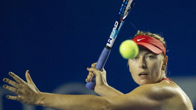 Russia's tennis player Maria Sharapova hits the ball during the Mexican Open in Acapulco on February 25, 2015
