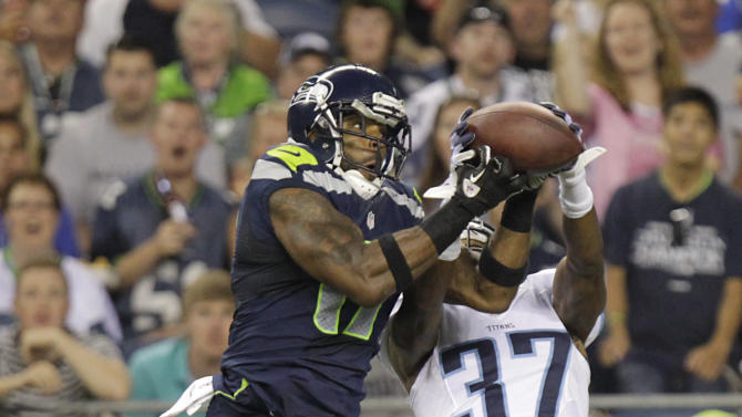 Seattle Seahawks wide receiver Braylon Edwards, left, pulls in a touchdown pass over Tennessee Titans defensive back Tommie Campbell (37) during the second half of an NFL football preseason game, Saturday, Aug. 11, 2012, in Seattle. (AP Photo/Rick Bowmer)