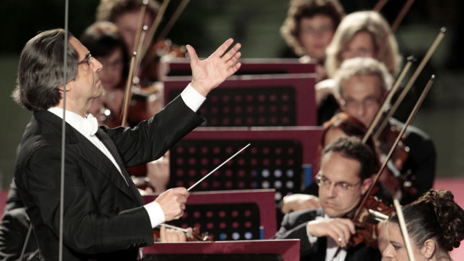 FILE - This May 11, 2012 file photo shows Riccardo Muti, conducts his orchestra during a concert  to celebrate Pope Benedict XVI's Pontificate at the Vatican. Muti, the master conductor, is sounding an ominous note, and it is not rising from the orchestra pit. Maestro Muti is worried that the stubborn financial crisis in much of the world risks impoverishing not just public coffers but also the arts, whose budgets, often lean in good economic times, are among the biggest casualties in many countries. (AP Photo/Gregorio Borgia, files)