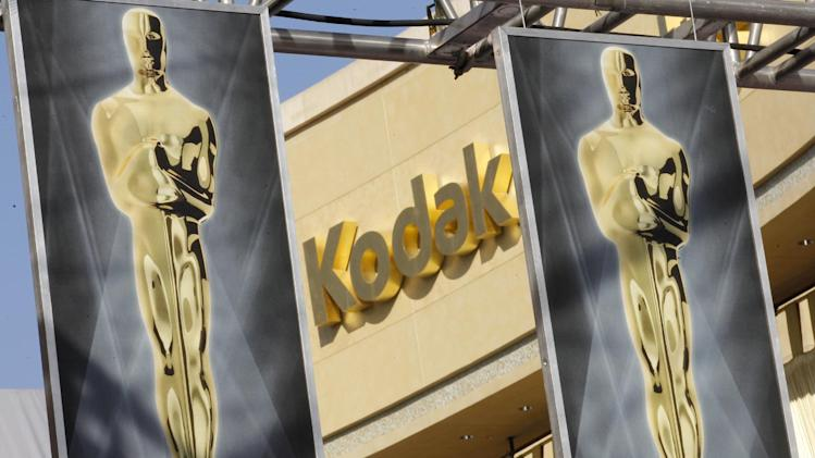 Oscar banners are seen outside the Kodak Theatre as preparations for the 84th Academy Awards continue in Los Angeles on Friday,  Feb. 24, 2012.  The Oscars will be held on Sunday. (AP Photo/Amy Sancetta)