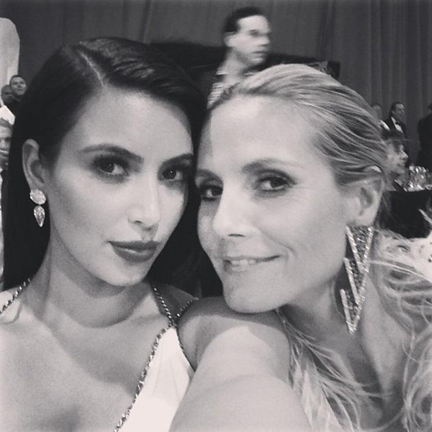 Oscars backstage: Kim Kardashian and Heidi Klum pose for a girly Twitpic at Elton John's after party. Copyright [Kim Kardashian]
