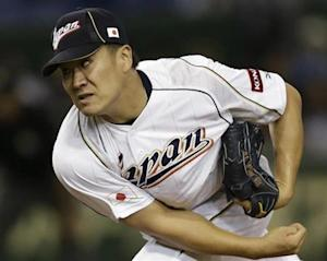 Japan's pitcher Tanaka pitches against the Netherlands in the fifth inning at the WBC second round game in Tokyo