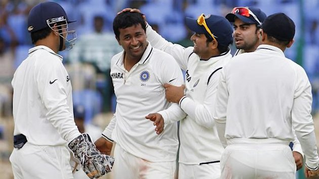 India cricketers celebrate a wicket
