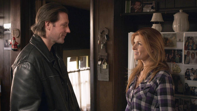 """This undated publicity image released by Tribeca Film shows Edward Burns, left, and Connie Britton in """"The Fitzgerald Family Christmas,"""" distributed by Tribeca Film. """"The Fitzgerald Family Christmas,"""" from filmmaker Edward Burns, is in limited release beginning Friday, Dec. 7, 2012, in theaters after debuting on iTunes and video on demand. (AP Photo/Tribeca Film)"""