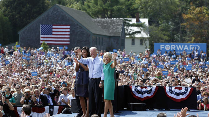 From left, President Barack Obama, first lady Michelle Obama, Vice President Joe Biden, and Jill Biden, react to the cheering crowd at a campaign event at Strawbery Banke Field, Friday, Sept. 7, 2012, in Portsmouth, N.H. (AP Photo/Carolyn Kaster)