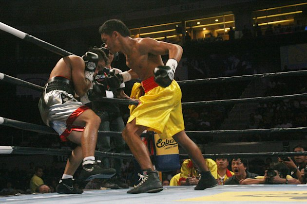 Thailand's Pungluang Sor Singyu has the Philippines' AJ Banal on the ropes in their WBO bantamweight title bout at the MOA Arena. (Angele Galia/NPPA Images)