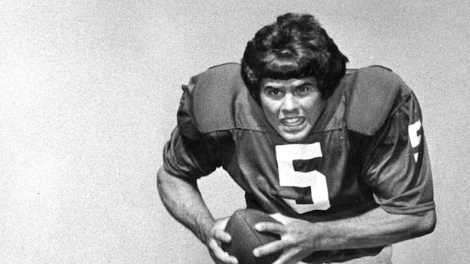 In this Aug. 20, 1973 file photo, University of Oklahoma quarterback Steven Davis is photographed at the teams media day in Norman, Okla. A University of Oklahoma official says the starting quarterback for Oklahoma's national championship teams in 1974 and 1975 is one of two men killed when a small plane slammed into a house in northern Indiana. St. Joseph County Coroner Randy Magdalinski identified the victims of Sunday's crash as 60-year-old Steven Davis and 58-year-old Wesley Caves, both of Tulsa, Okla.  (AP Photo/The Oklahoman, File)