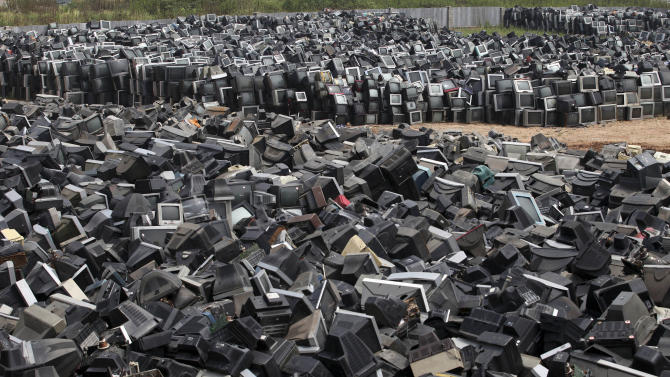 In this photo taken Aug. 26, 2013, discarded television sets pile up in a scrap yard awaiting recycling in Zhuzhou city in south China's Hunan province. China's recycling industry has boomed over the past 20 years. Its manufacturers needed the metal, paper and plastic and Beijing was willing to tolerate the environmental cost. But environmentalists have long complained the industry is poisoning China's air, water and soil. (AP Photo) CHINA OUT