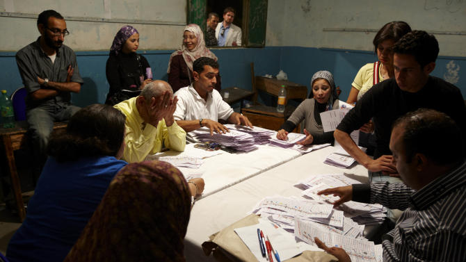 Egyptian election workers count the ballots following the end of the two day presidential election in Cairo, Egypt, Thursday, May 24, 2012. As vote-counting began, exit polls by several Arab television stations suggested the Brotherhood's Mohammed Morsi was ahead of the pack of 13 candidates. The reliability of the various exit surveys was not known, and a few hours after the end of two days of voting, only a tiny percentage of the ballots had been counted. (AP Photo/Fredrik Persson)