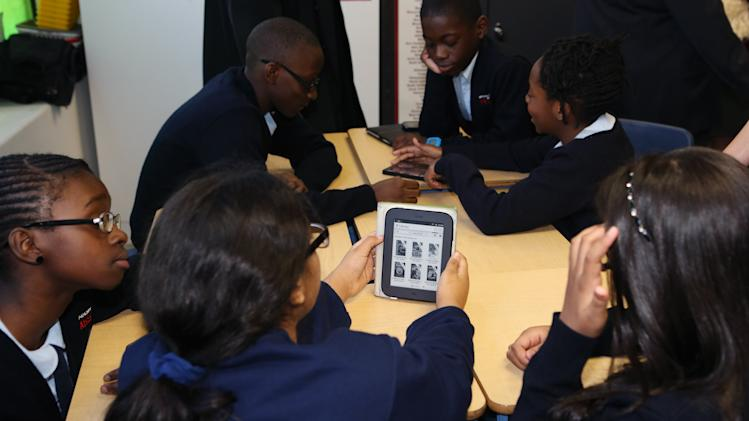 Students use an e-reader on a tablet at the Bronx Academy of Promise where the Verizon Foundation announced national survey results that surprisingly reveal middle school students use mobile technology to do homework, Wednesday, Nov. 28, 2012, in the Bronx borough of New York. The Verizon Foundation launched a national student app contest to encourage interest in science, technology, engineering, and math with mobile technology. www.verizonfoundation.org/appchallenge (John Minchillo/AP Images for Verizon Foundation)