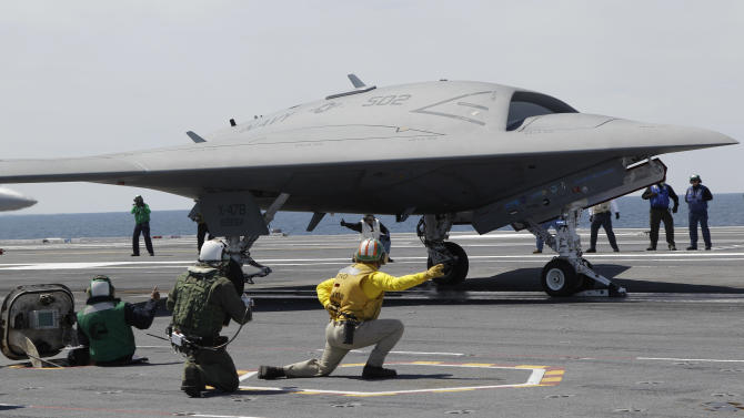 A Navy X-47B drone is launched off the nuclear powered aircraft carrier USS George H. W. Bush off the coast of Virginia, Tuesday, May 14, 2013. The plane isn't intended for operational use, but it will be used to help develop other unmanned, carrier-based aircraft. (AP Photo/Steve Helber)