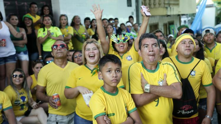 Fans watch a match between Cameroon and Brazil during the 2014 soccer World Cup in Manaus, Brazil, Monday, June 23, 2014. (AP Photo/Marcio Jose Sanchez)