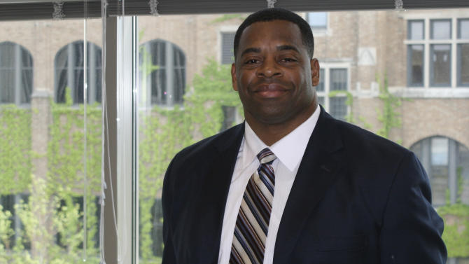 In this May 17, 2012, photo, former NFL linebacker George Koonce poses for a photo at Marquette University in Milwaukee. Koonce, with the help of his late wife, Tunisia, turned his life around after struggling with depression, inactivity, and suicidal tendencies after his football career ended following the 2000 season. Finishing his doctoral dissertation at Marquette was Koonce's tribute to Tunisia, who died of breast cancer in 2009, and he now is using his own personal struggles to fuel an academic study of the issues former players face when their careers are over. (AP Photo/Chris Jenkins)