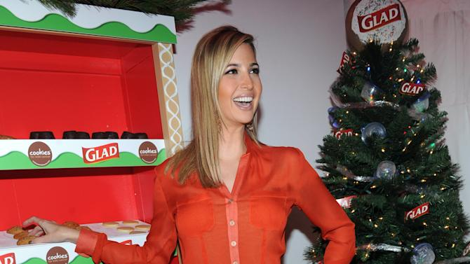 IMAGE DISTRIBUTED FOR GLAD - Ivanka Trump, mother and businesswoman, joins The Glad Products Company to celebrate National Cookie Day and the 89th annual New York Stock Exchange tree lighting by giving away thousands of cookies, Tuesday, Dec. 4, 2012, in New York.  For every cookie exchanged this holiday season, Glad will make a donation to its longstanding partner Cookies for Kids' Cancer, a nonprofit that raises funds for pediatric cancer research through cookie sales. (Photo by Diane Bondareff/Invision for Glad/AP Images)