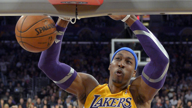 "FILE - In this Jan. 25, 2013, file photo, Los Angeles Lakers center Dwight Howard dunks during the first half of their NBA basketball game against the Utah Jazz, in Los Angeles. Dallas Mavericks owner Mark Cuban tweeted Friday, July 5, 2013, that it was ""time to get back to work"" amid multiple media reports that Dallas was out of the running for free agent Howard. (AP Photo/Mark J. Terrill, File)"