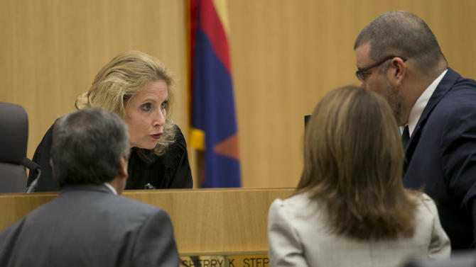 Judge Sherry Stephens speaks with attorneys during the Jodi Arias trial at Maricopa County Superior Court in Phoenix on Wednesday, Feb. 27, 2013. Arias is on trial for the killing of her boyfriend, Travis Alexander, in 2008. (AP Photo/The Arizona Republic, David Wallace, Pool)