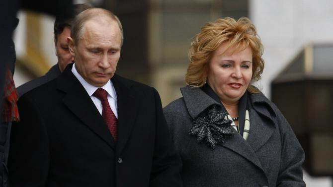FILE - In this Sunday, March 4, 2012 file photo then Russian Prime Minister and presidential candidate Vladimir Putin and his wife Lyudmila leave a polling station in Moscow, Russia. Russian President Vladimir Putin and his wife Lyudmila have announced they are divorcing. Married just a few weeks short of 30 years, the Putins announced the decision on state television after attending a ballet performance Thursday evening in the Kremlin.( AP Photo/Alexander Zemlianichenko, file)