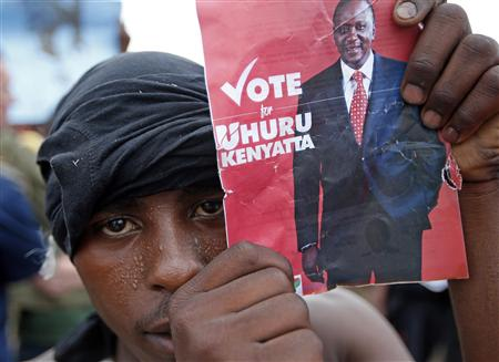 Supporter of presidential candidate Uhuru Kenyatta celebrates on the outskirts of Nairobi