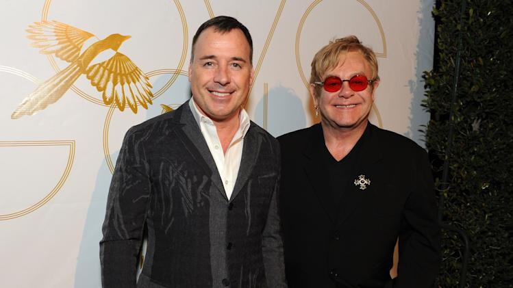 "David Furnish and Elton John attend LoveGold/EJAF Celebrate ""How to Survive a Plague"" at Chateau Marmont on February 22, 2013 in Los Angeles. (Photo by Jordan Strauss/Invision for LoveGold/AP Images)"