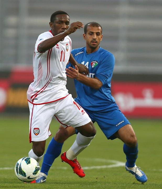 Ahmad Khalil Omar Abelahman (L) of United Arab Emirates vies for the ball against Husain al-Shammari of Kuwait during the two teams' semi-final match in the 21st Gulf Cup in Manama,on January 15, 2013