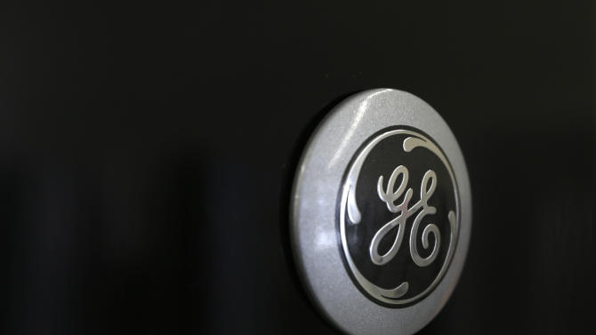 In this Tuesday, Feb. 26, 2013, photo, a General Electric logo is seen on a refrigerator at Green's, a furniture and appliance store, in Albany, N.Y. General Electric Co. reports quarterly financial results before the market opens on Friday, April 19, 2013. (AP Photo/Mike Groll)