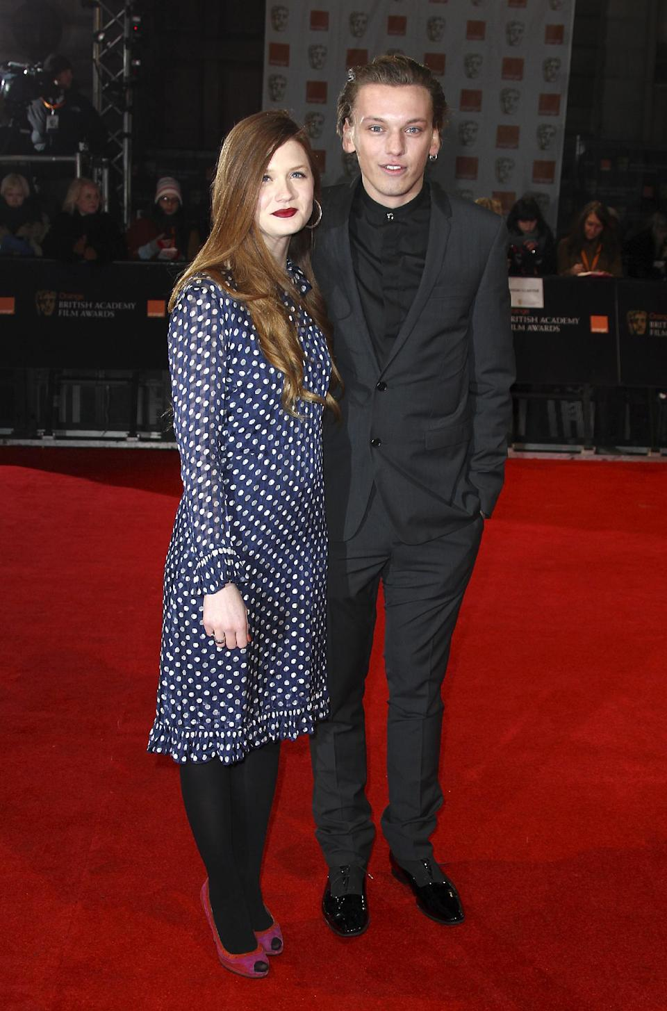 Actress Bonnie Wright, left, and actor Jamie Campbell Bower, right, arrives for the BAFTA Film Awards 2012, at The Royal Opera House in London, Sunday, Feb. 12, 2012. (AP Photo/Joel Ryan)