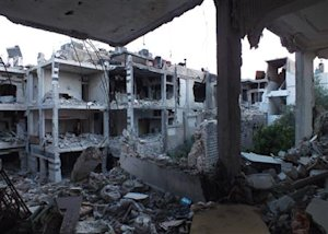 A general view shows damaged buildings in the besieged…