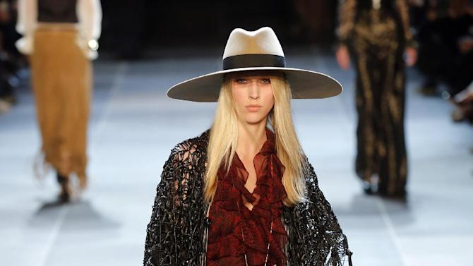 A model wears a creation by French born fashion designer Hedi  Slimane for Saint Laurent ready to wear Spring-Summer 2013 collection, presented in Paris, Monday, Oct. 1, 2012. (AP Photo/Jacques Brinon)