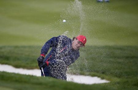 Haas grabs crucial point as U.S. wins Presidents Cup