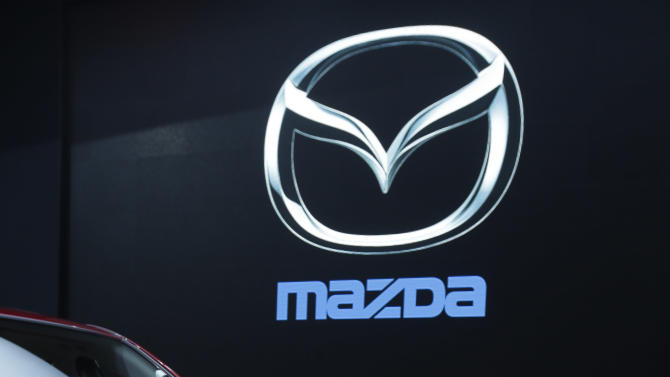 Mazda6 is shown during it's North American debut at the LA Auto Show in Los Angeles, Thursday, Nov. 29, 2012. The annual Los Angeles Auto Show opened to the media Wednesday at the Los Angeles Convention Center. The show opens to the public on Friday, November 30. (AP Photo/Chris Carlson)