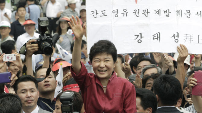 "FILE - In this Tuesday, July 10, 2012 file photo, Park Geun-hye, a former leader of the conservative ruling Saenuri Party, waves to her supporters during a ceremony to announce her plan to run for president in Seoul, South Korea. Park served five terms in the legislature and earned the nickname ""Queen of Elections"" for her ability to win tight races. She only narrowly lost in presidential primaries five years ago to current conservative President Lee Myung-bak, whose single term ends in February. Park attempts to become the country's first female president and keep the government in conservative hands in the Dec. 19, 2012 election.  (AP Photo/Ahn Young-joon, File)"