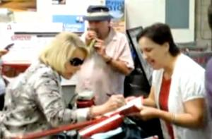 Joan Rivers Handcuffs Herself to Costco Shopping Cart in Protest