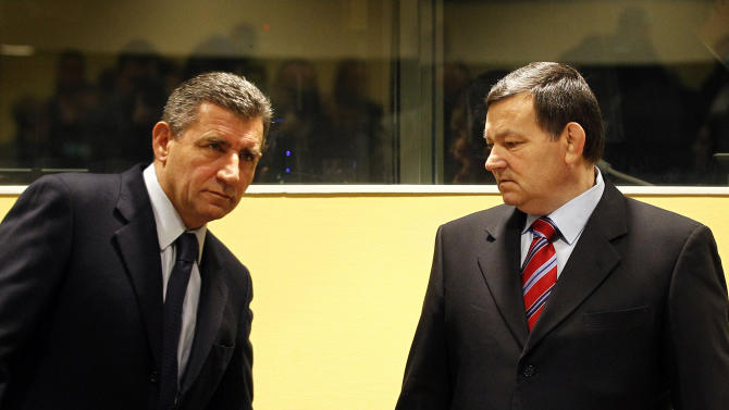 Former Croatian Army Generals Ante Gotovina, left, and Mladen Markac, right, enter the courtroom of the Yugoslav war crimes tribunal (ICTY) for their appeal judgement in The Hague, Netherlands, Friday, Nov. 16, 2012. The ICTY is delivering its decision in the appeal of two Croatian generals convicted for their roles in a 1995 military offensive to drive Serb rebels out of land they had occupied for years along part of Croatia's border with Bosnia. Gotovina and Markac, were sentenced to 24 and 18 years respectively in 2011 for war crimes and crimes against humanity. (AP Photo/Bas Czerwinski, Pool)