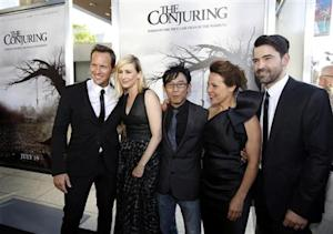 """Wan poses with cast members Wilson, Farmiga, Taylor and Livingston at the premiere of """"The Conjuring"""" at the Cinerama Dome in Los Angeles"""