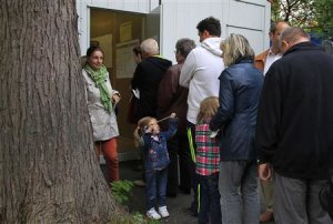 People line-up in front of polling station to vote…